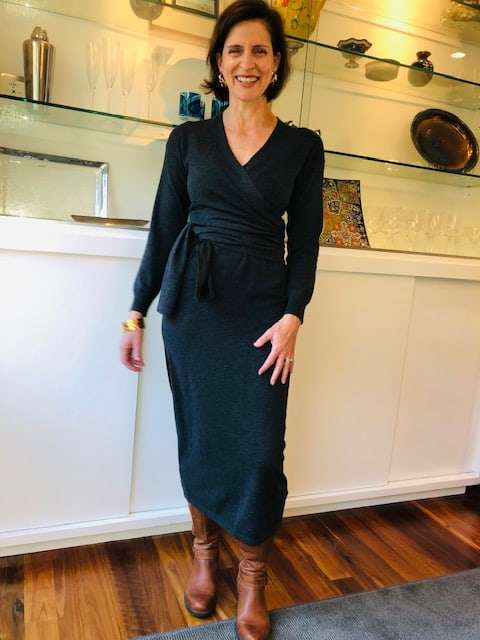 wrap sweater dress in dark grey that is a great option for a thanksgiving dinner dress