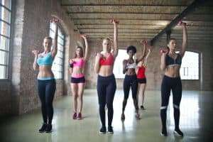 women in a group exercise class wearing leggings. The learned how to motivate for a workout with great leggings.